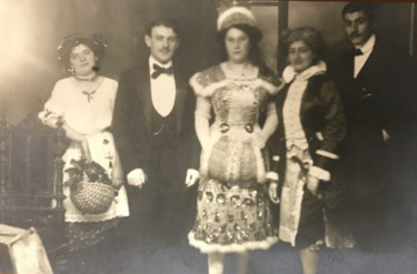my grandmother Anna and her brothers on her way to a costume ball, sometime before 1920